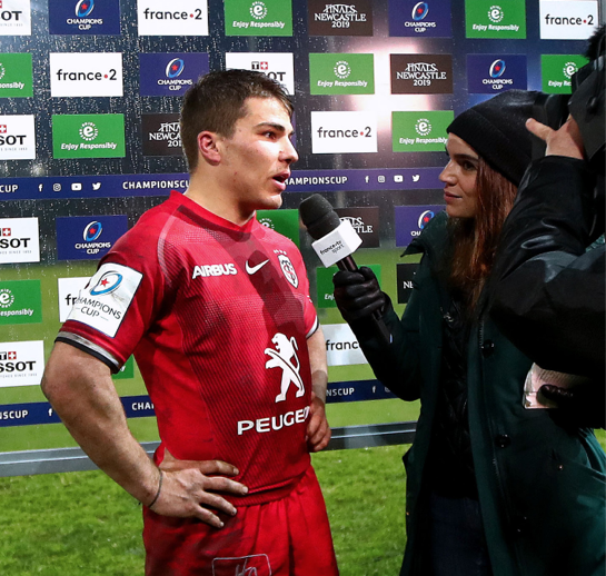 Rugby player interviewed on pitch