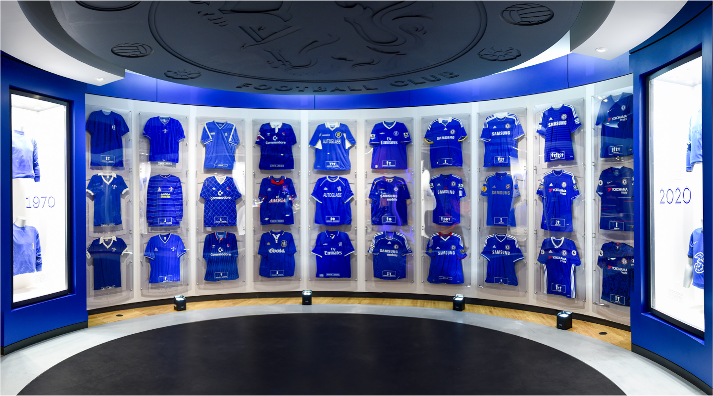Chelsea FC blue football shirts in glass display